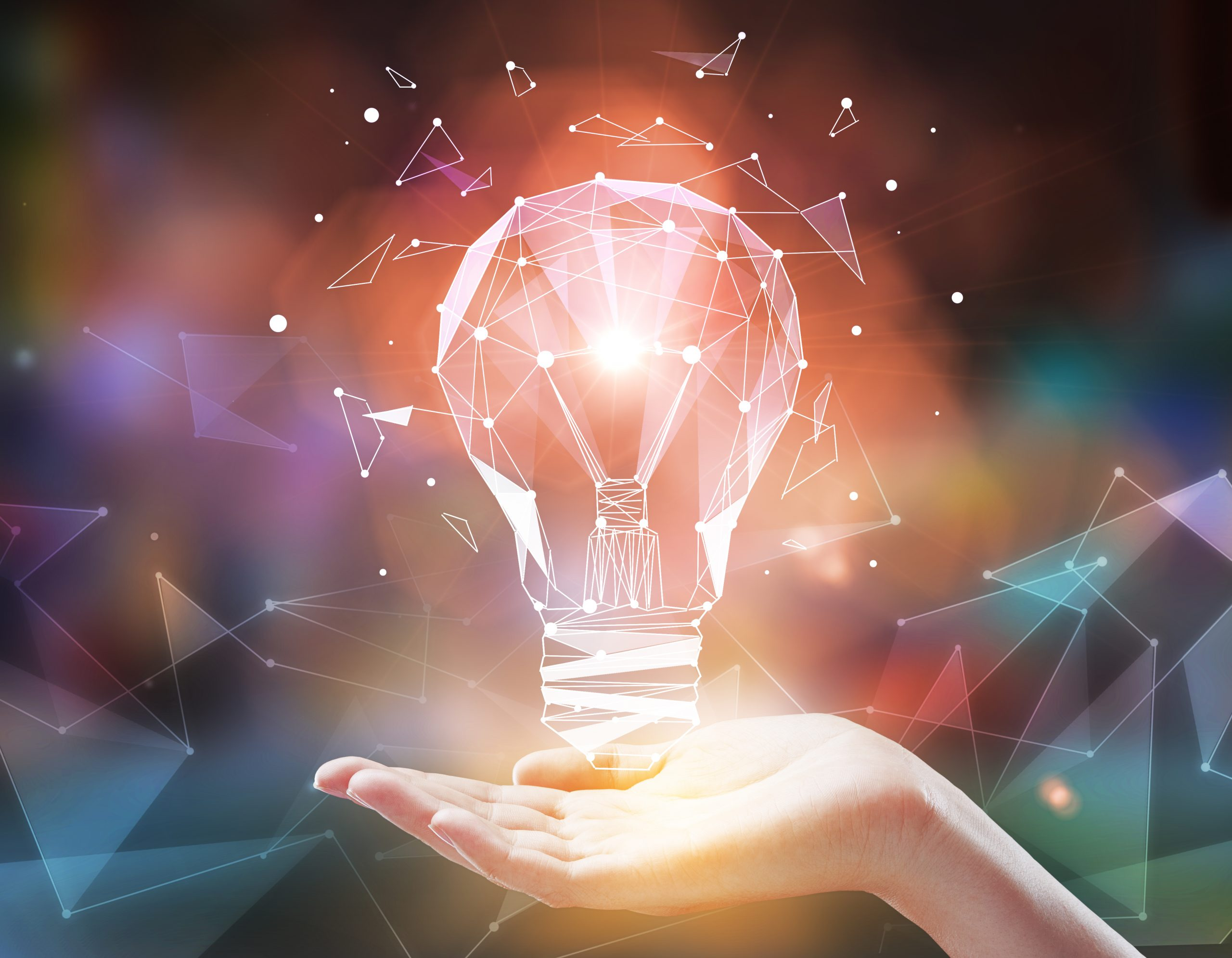 Hand holding abstract lamp on blurry polygonal background. Imagination and technology concept. 3D Rendering