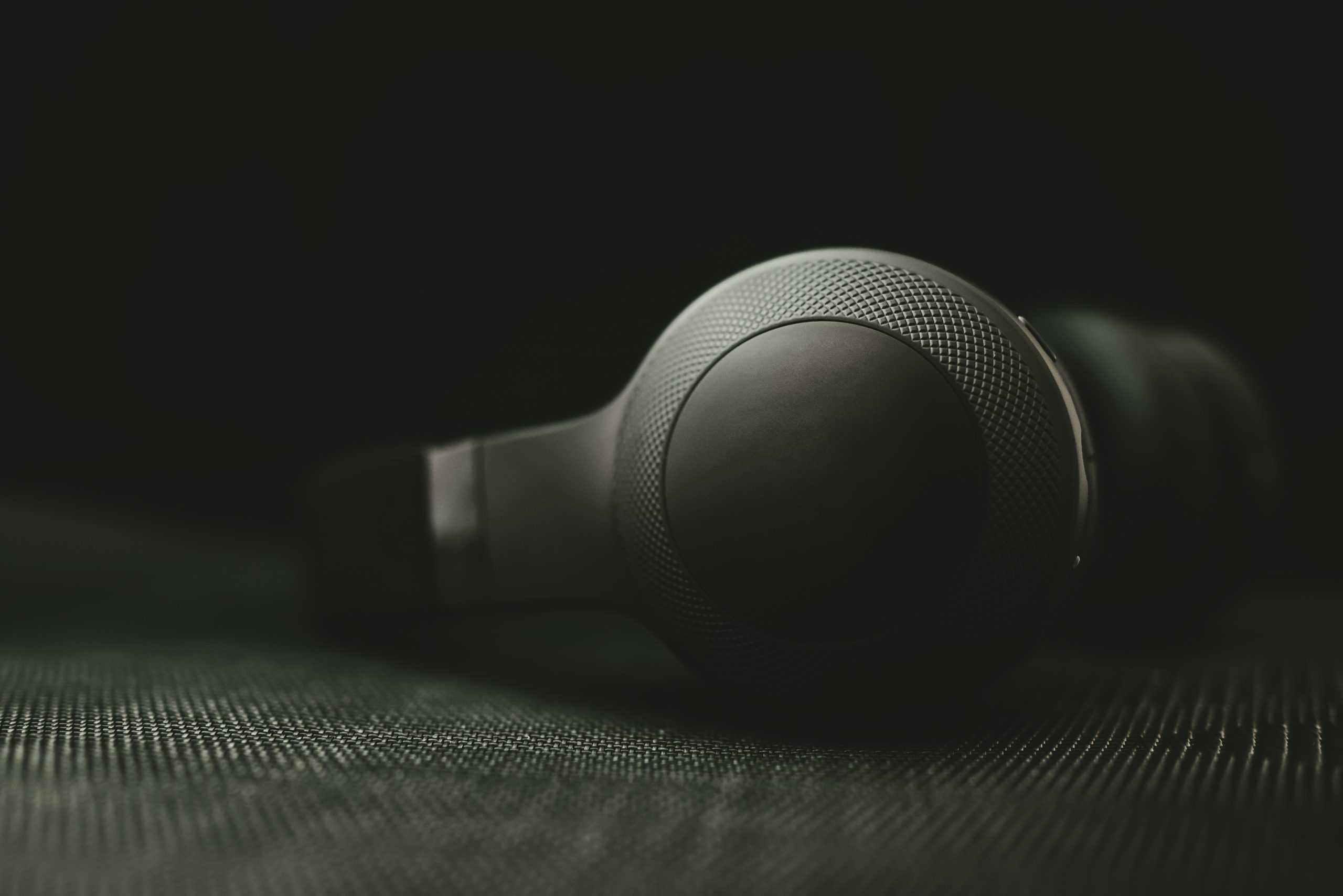 Black headphones in the dark. Small depth of field